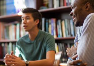 Graduate student talking to professor